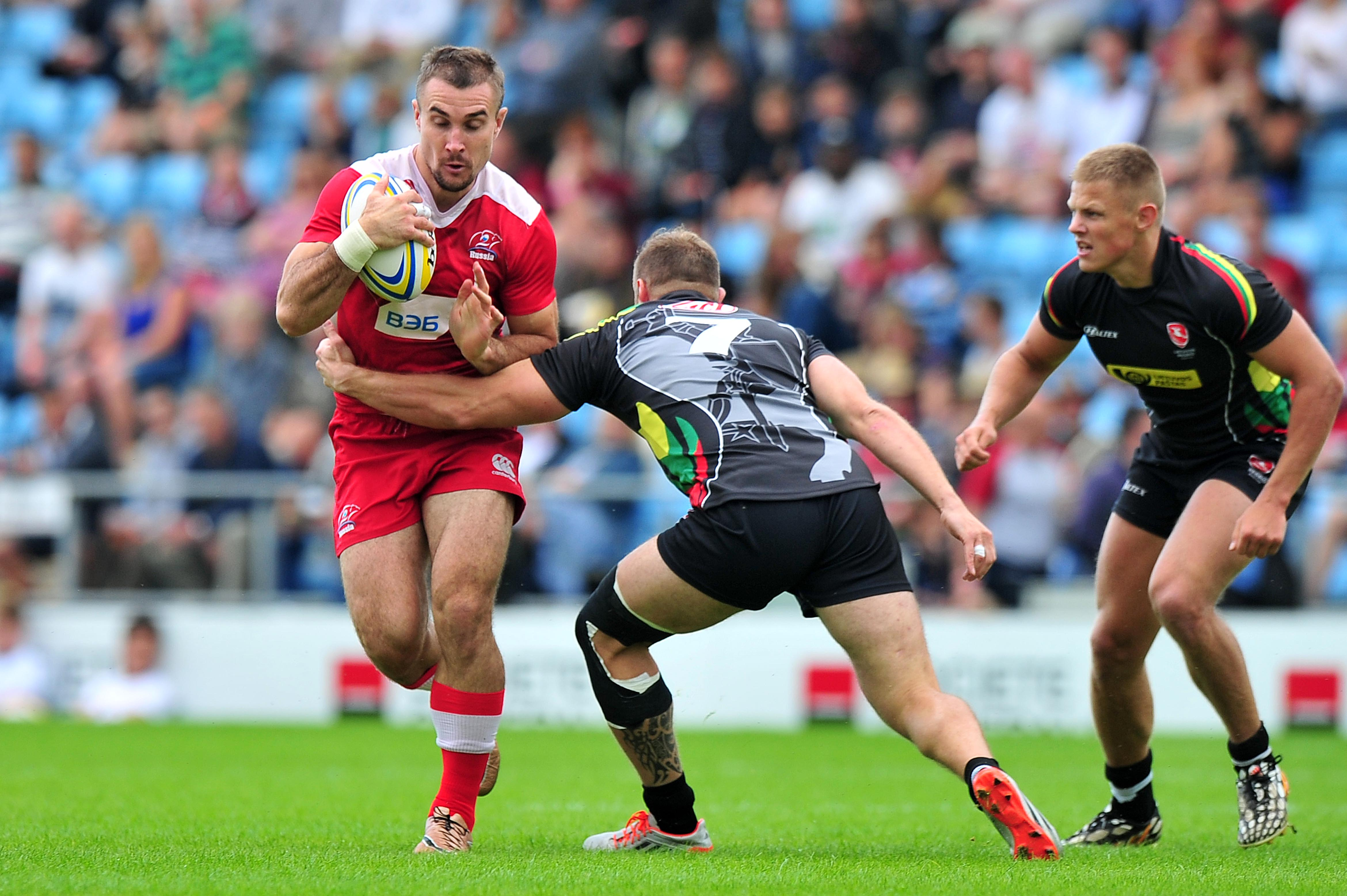 Vladmir Ostroushko of Russia is tackled by Justinas Vasiliauskas of Lithuania - Photo mandatory by-line: Tom Sandberg/Pinnacle/RFU - Tel: +44(0)1363 881025 - Mobile:0797 1270 681 - 09/07/16 - Sport - Rugby - Rugby Europe 7s Grand Prix  - Mitsubishi Motors Exeter 7s - Russia v Lithuania - Sandy Park, Exeter, Devon
